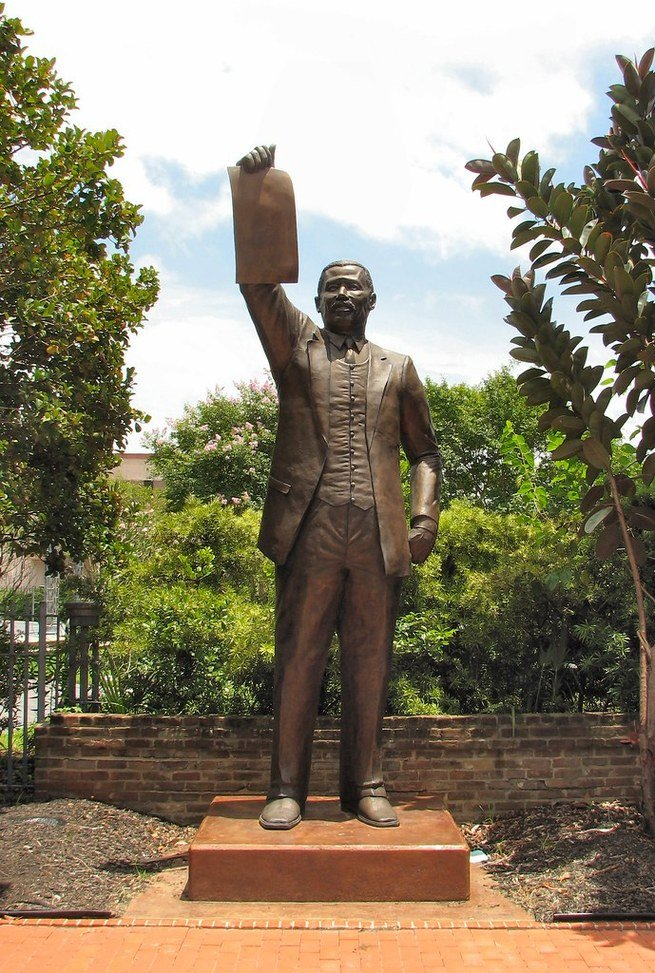 Statue of the Texas State Legislator Al Edwards holding up the 1979 legislation making Juneteenth a paid Texas state holiday