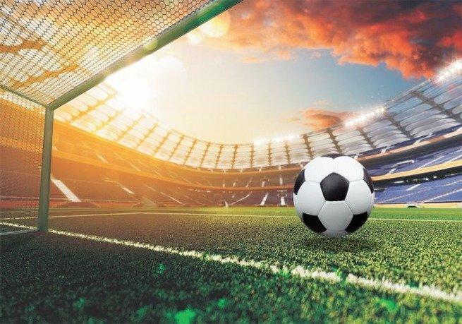 Destaque de bola no campo de futebol